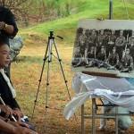 在りし日の伊舍堂用久中佐と隊員の写真パネルが披露された