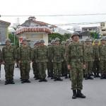 発に際し、決意表明する即応予備自衛官=25日、沖縄県那覇市の陸上自衛隊第15旅団