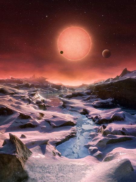 みずがめ座の方向、小さく暗い星に3惑星を発見
