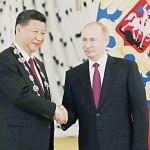 習近平氏(左)とプーチン氏