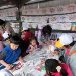 12月19日、台北市内で行われた親民党の選挙集会では、子どもたちが総統選候補者らの塗り絵コーナーを設置して展示するコーナーもつくった